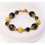 Gylden armbånd med svarte og gylne stardust perler