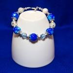 Sølv armbånd med hvite shamballa og blå perler