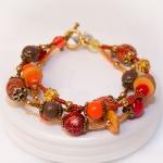 """""""Høst Stil"""" - Antikk gylden tre rader armbånd med røde og oransje treperler"""
