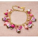 Gylden armbånd med porselen perler med rose blomster