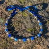 Sølv halssmykker med blå og hvite shamballa perler