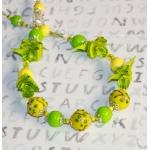 Sølv halssmykke med gule og grønne lampwork-perler