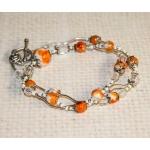 Sølv halssmykke med hvite og oransje perler